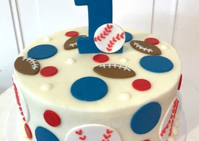 Baseball and football first birthday cake.
