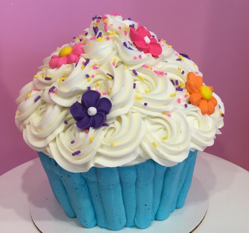 Giant Cupcake with Colorful Flowers and Sprinkles