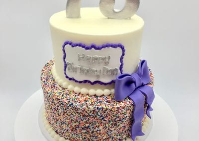 2 Tier Colorful Birthday Cake with Purple Bow   3 Sweet Girls Cakery