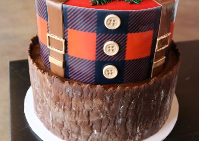 2 Tier Lumbarjack Cake with Plaid and Boots on Top | 3 Sweet Girls Cakery