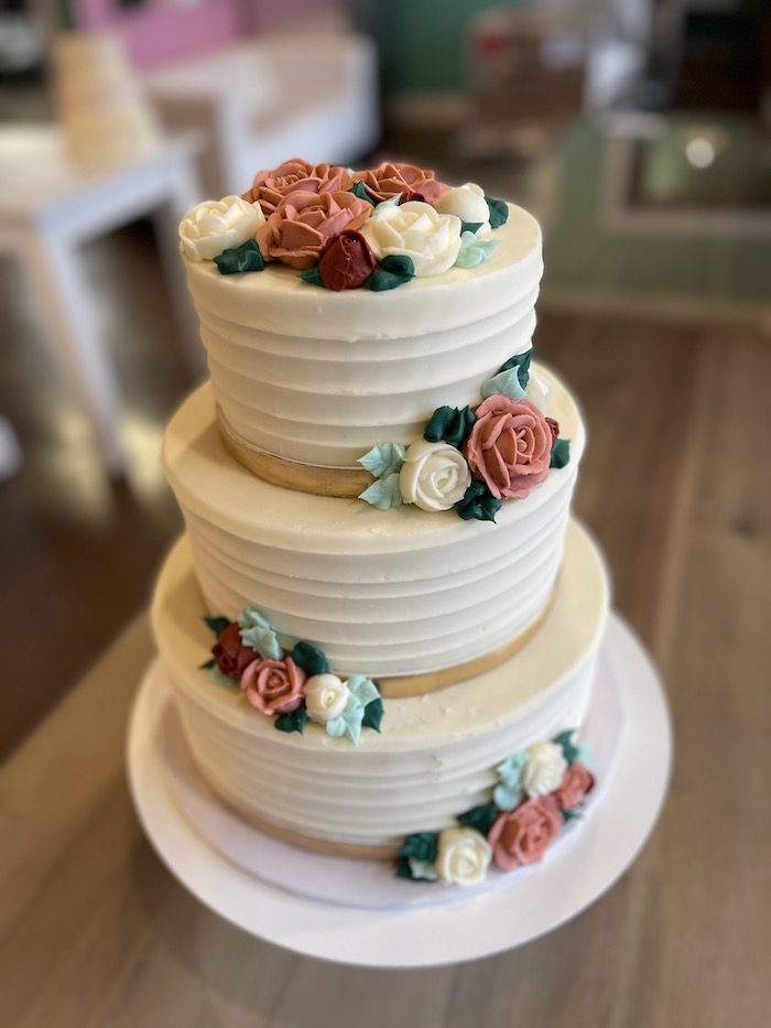 3 Tier Wedding Cake with Gold Bands and Buttercream Flowers | 3 Sweet Girls Cakery