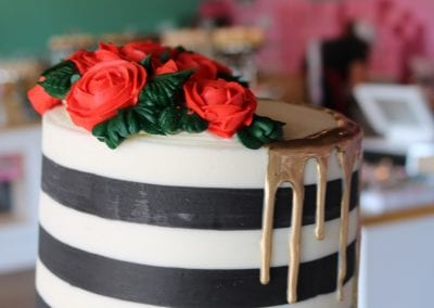 Black and White Striped Cake with Red Roses and Gold Drip | 3 Sweet Girls Cakery