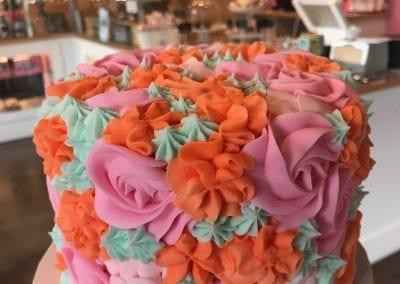 Bright Mixed Rosette Cake | 3 Sweet Girls Cakery