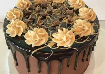 Buckeye Chocolate Peanut Butter Drip Cake | 3 Sweet Girls Cakery