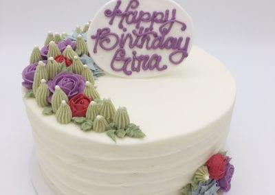 Buttercream Floral Cake Pink and Purple Flowers with Succulants | 3 Sweet Girls Cakery