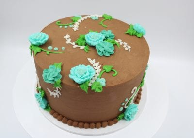 Chocolate Cake with Teal Buttercream Flowers | 3 Sweet Girls Cakery