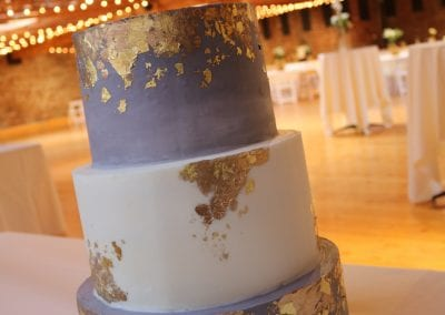 Gray and White 3 Tier Wedding Cake with Gold Foil at Rhinegheist Brewery | 3 Sweet Girls Cakery