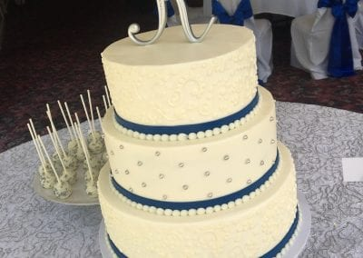 White Wedding Cake with Navy Ribbons and Silver Pearls | 3 Sweet Girls Cakery