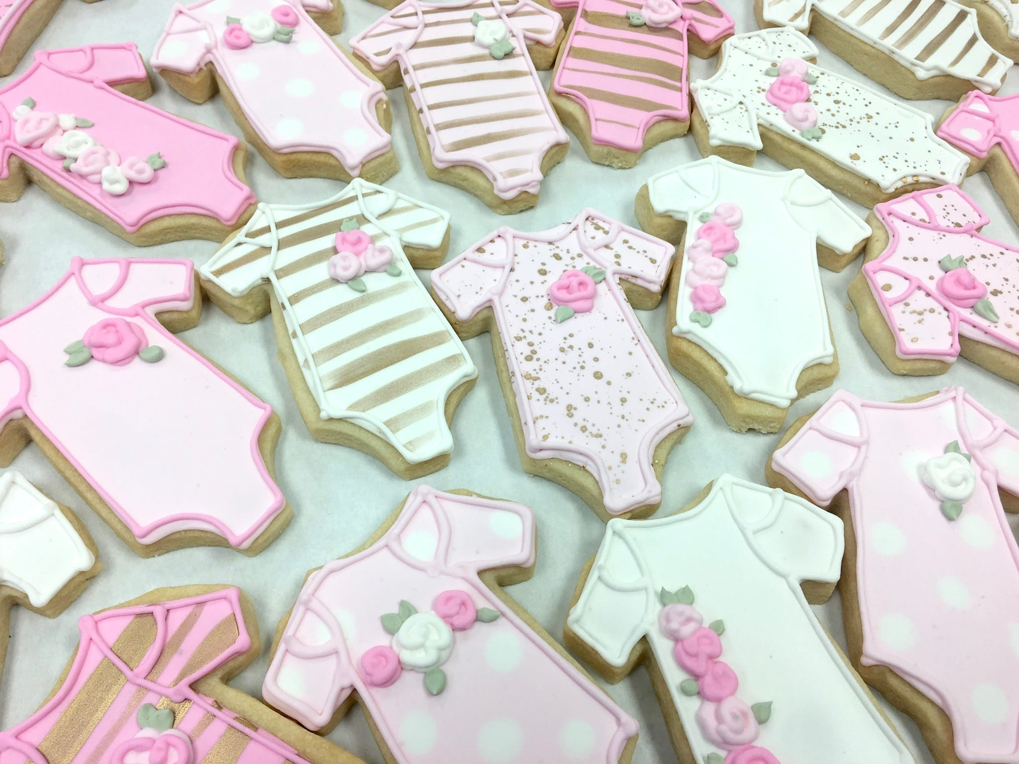 Pink and Gold Baby Onesie Cookies with Rosettes | 3 Sweet Girls Cakery