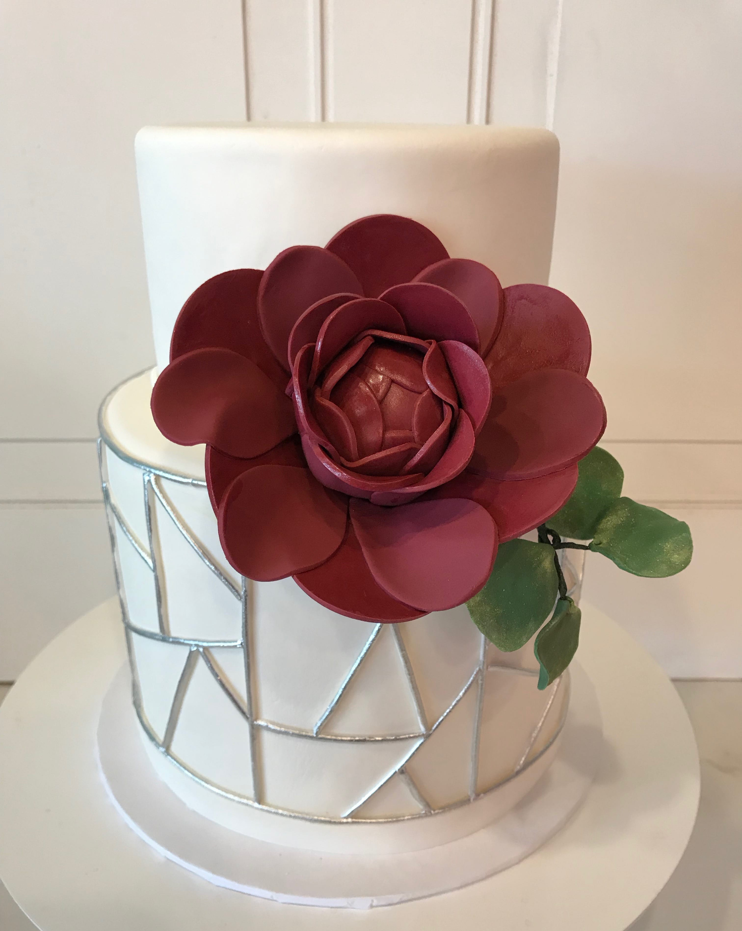 2 Tier White Cake with Silver Geometric Shapes and Burgundy Flower | 3 Sweet Girls Cakery