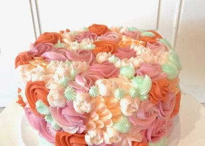 Peach and Coral Mixed Rosette Cake | 3 Sweet Girls Cakery