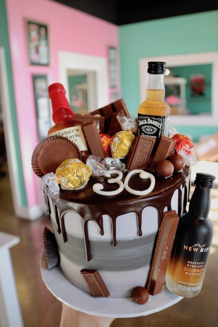 Mini Alcohol Bottles on Chocolate Drip Cake   3 Sweet Girls Cakery