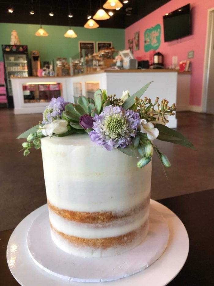 Naked Vanilla Cake with Lavender Flowers and Greenery | 3 Sweet Girls Cakery