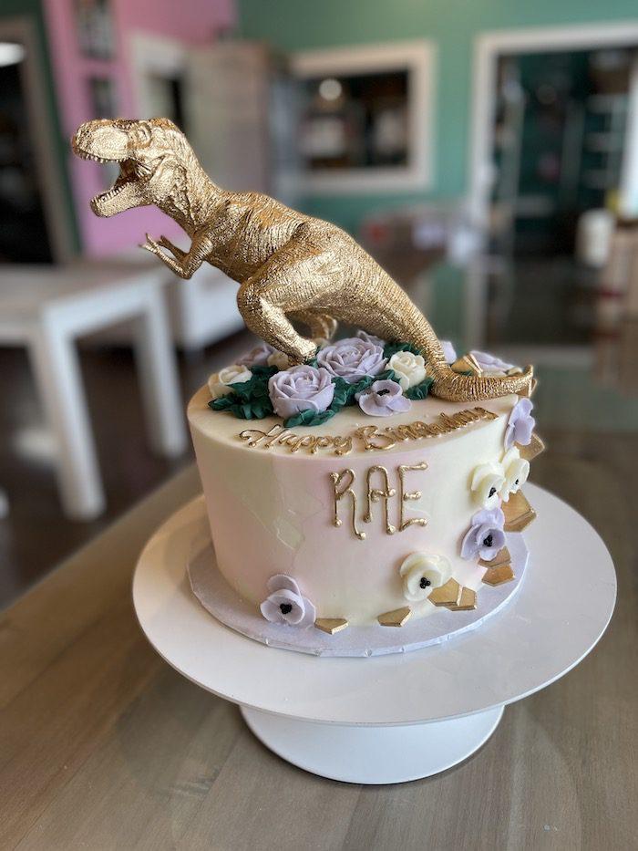 Pink and Gold Dinosaur Birthday Cake