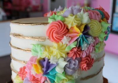 Trendy Cake with Gold Stripes and Bright Mixed Color Rosettes | 3 Sweet Girls Cakery