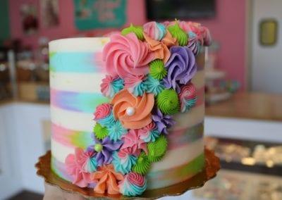 Trendy Striped Birthday Celebration Cake with Rosettes | 3 Sweet Girls Cakery