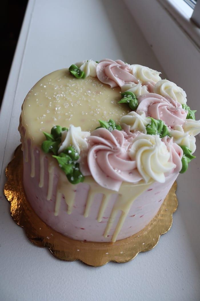 White Chocolate Raspberry Floral Drip Cake   3 Sweet Girls Cakery
