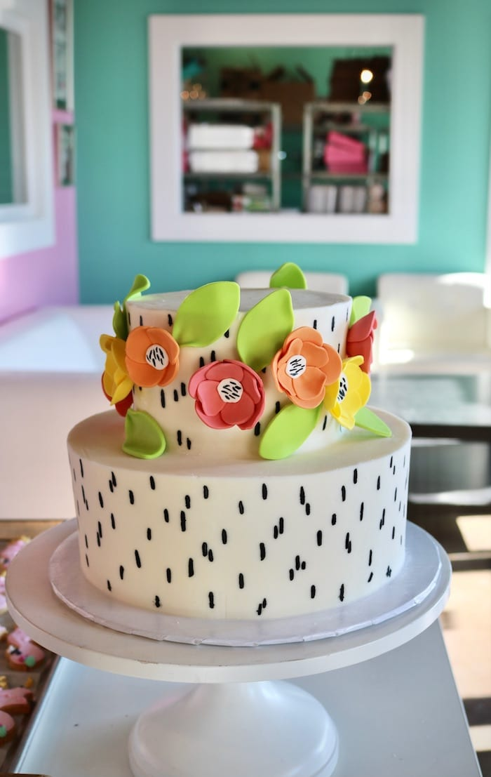White and Black 2 Tier with Bright Flowers   3 Sweet Girls Cakery